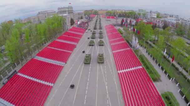 Armoured units drive along empty tribunes