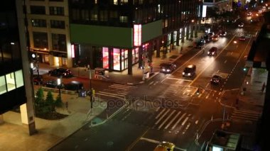 corner of streets with cars at night in New York