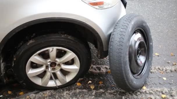 Flat Tire Of Modern Car Jack And Spare Wheel An Asphalt Stock