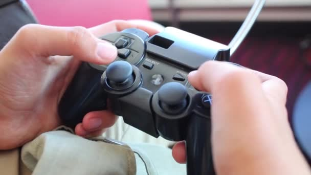 Boy push buttons of video game console controller