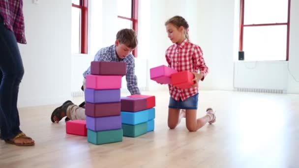 mother with children play with cubes
