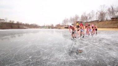 People in underwear skates as train on ice rink