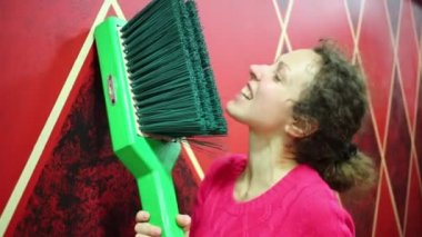 woman brushing her teeth by huge brush