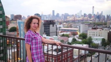 Pretty woman on roof in New York