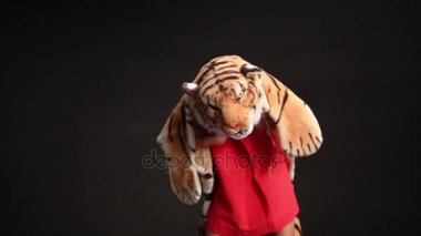 girl in dress and soft costume of tiger