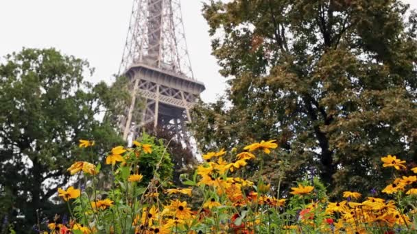 Tower behind orange flowers and trees