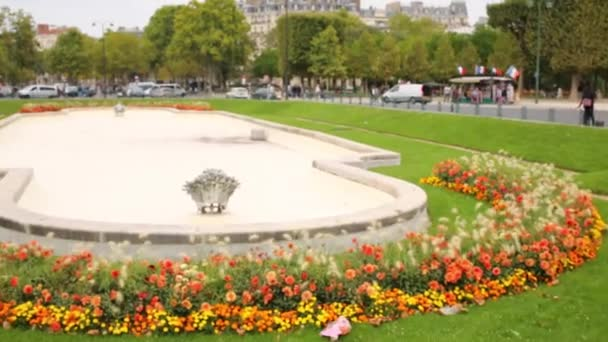 Flowerbed on Place Jacques Rueff and Eiffel Tower