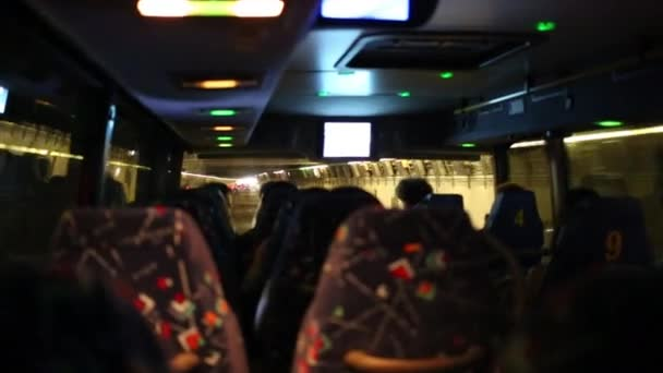 People in bus moving in tunnel during trip in USA