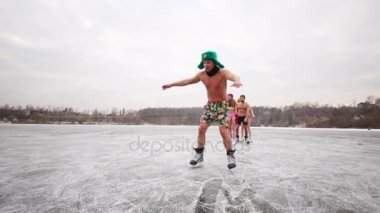 boys and girls in swimsuits on ice rink