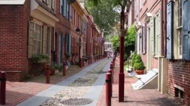 PHILADELPHIA, USA - SEPTEMBER 02, 2014: People walks on the oldest street in America - Elfreth Alley. Street founded in 1702