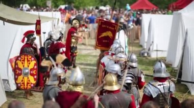 Detachment of Roman Legion in defense and weapons and standard with the words Leg X Fret.