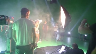 MOSCOW - JULY, 23, 2015: Shooting singer in haze and in bright light on Bukatara shooting video Turn. All her adult life Bukatara dedicated to music, not only as performer but also as writer.