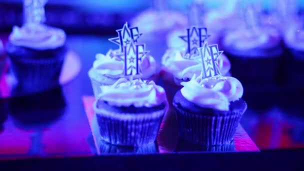 MOSCOW - APR 26, 2015: Muffins with logo of magazine at celebration of first year of LF City magazine in Chicago karaoke club