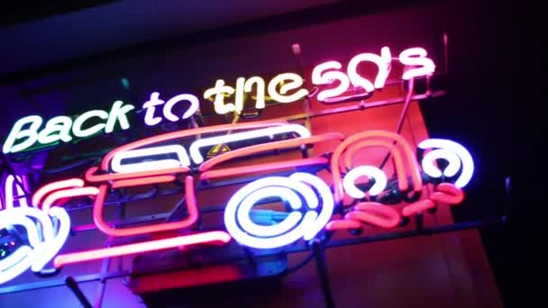 Back to 50s and car neon signs on wall in retro restaurant
