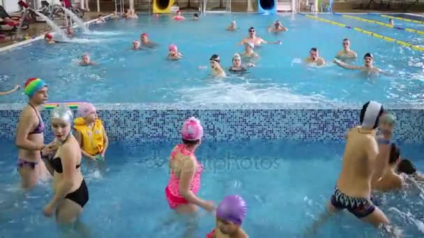 LECHISCHEVO, RUSSIA - FEB 23, 2015: People play in indoor pool in Holiday House and Hotel Avantel Club Istra - modern hotel located 55 km from Moscow, on picturesque shore of Istra reservoir
