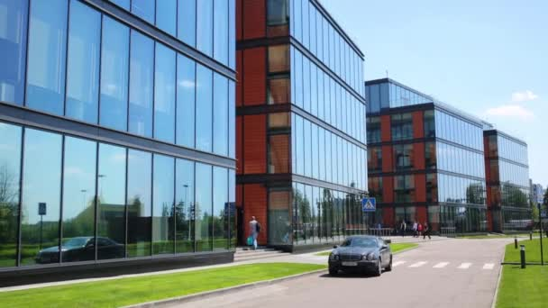 MOSCOW - JUN 03, 2015: Business center Olympia Park and car. Olympia Park complex has offices, sports complex and park