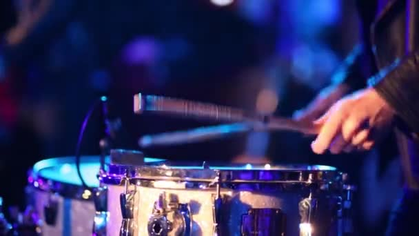 Close up view of drummer performing in night club, video with sound
