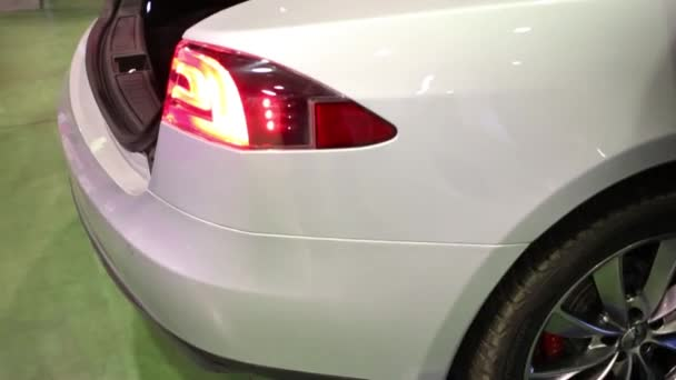 MOSCOW, RUSSIA - MAR 14, 2015: Electric car Tesla with open trunk at the  Third International Exhibition MATE 2015 in Exhibition Center Sokolniki