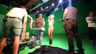 MOSCOW - JULY, 23, 2015: Singer doing elegant move hands and film crew shooting her on Bukatara shooting video Turn. Maria Bukatara performed in group Propaganda.