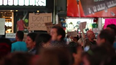 NYC, USA - AUG 22, 2014: Protesters with placards against cops shoot in unarmed civilian on Broadway.