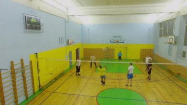 MOSCOW - NOV 26, 2015: Volleyball training of adult people team in gym.