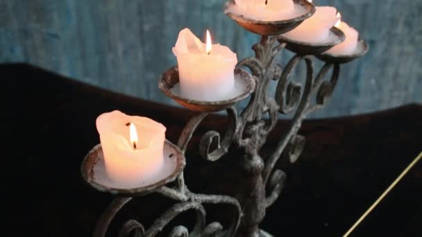 Five burning candles on beautiful wrought-iron candlestick