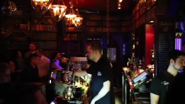 MOSCOW - MAR 25, 2015: People rest in bar in 16 Tons night club at concert T-killah