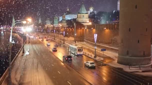 Top view of cars on road, Kremlin wall and snowfall in Moscow
