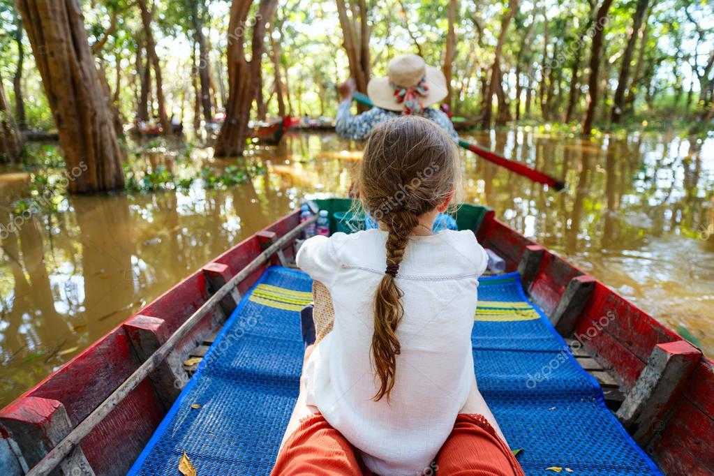 Little girl at flooded forest