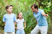 Fotografie Vater und zwei Kinder