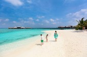 Family mother and kids enjoying tropical beach vacation