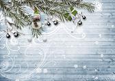 Fotografie Weihnachtskarte. Mit verschneiten Tannenzweigen