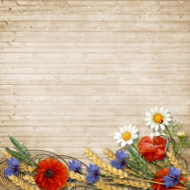 Wild flowers with spikelets on a wooden background