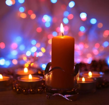 burning candle and colored side for decoration