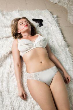 Lifeless woman lying on the floor