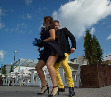 Couple of dancers dancing bachata on a city street