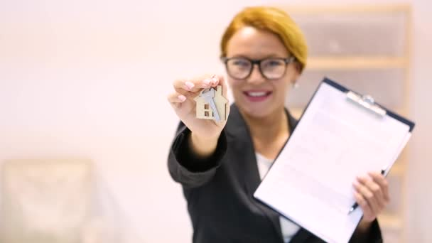 Realtor with key for apartment or flat