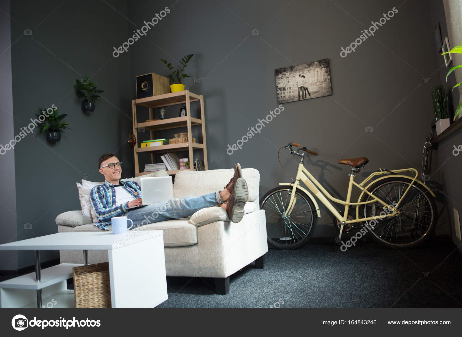 Wondrous Freelancer Man On Sofa Working On Distance From Office Spiritservingveterans Wood Chair Design Ideas Spiritservingveteransorg
