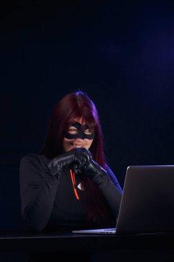 Night thief in black mask