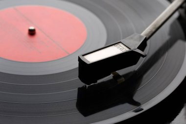 Black vinyl plate with player