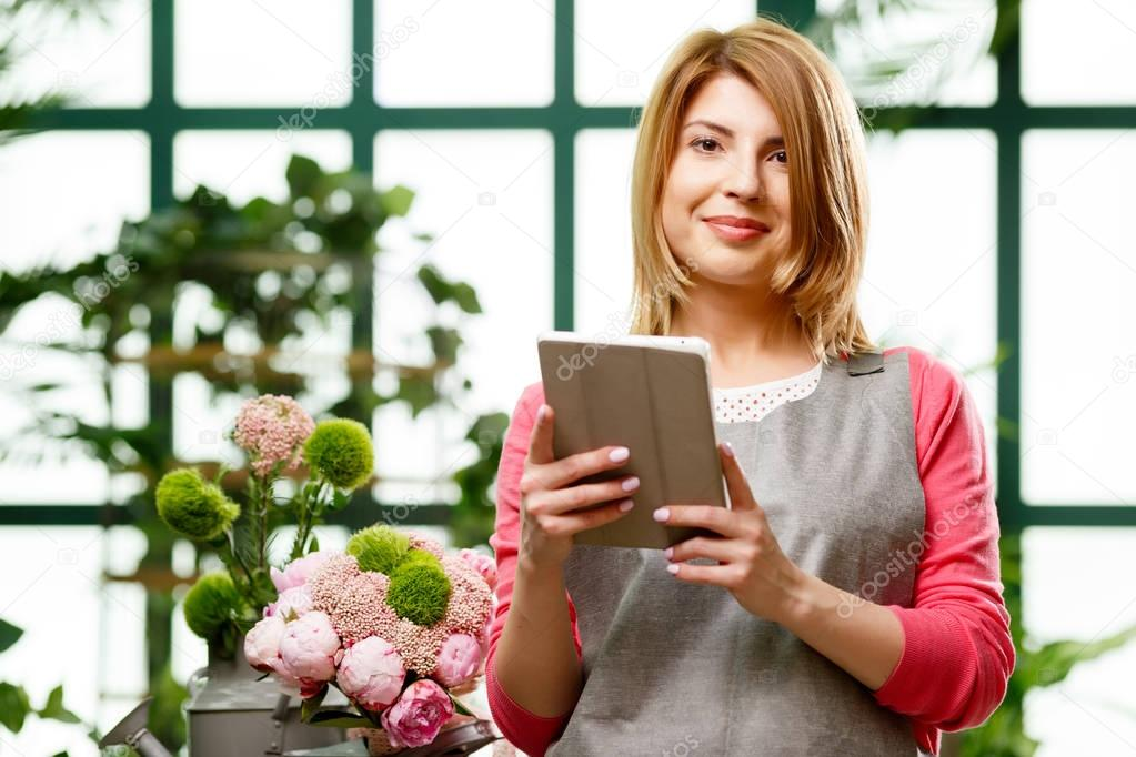 Florist with tablet in hands