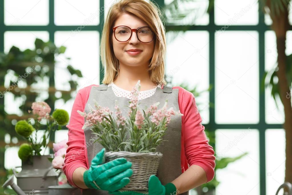 Florist in green rubber gloves