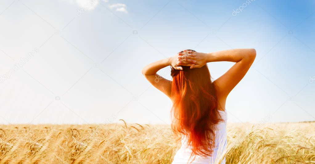 Image from back woman on wheat field