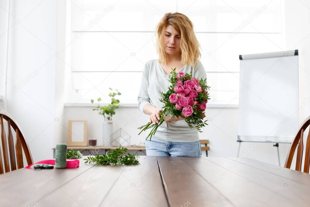 Photo of florist woman making bouquet