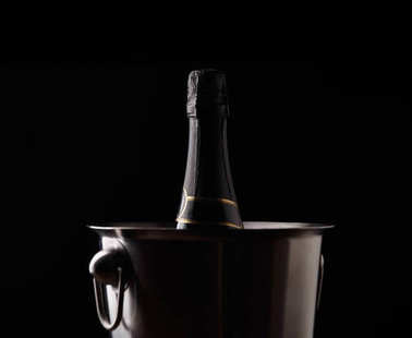 Picture of bottle of wine in iron bucket