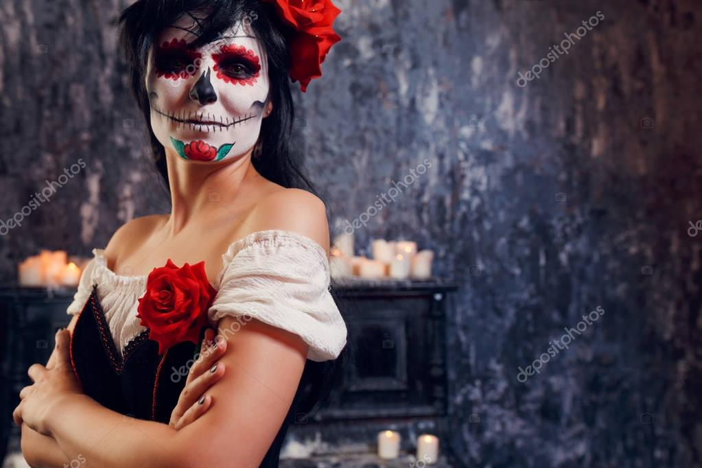 Halloween image of smiling zombie girl with makeup
