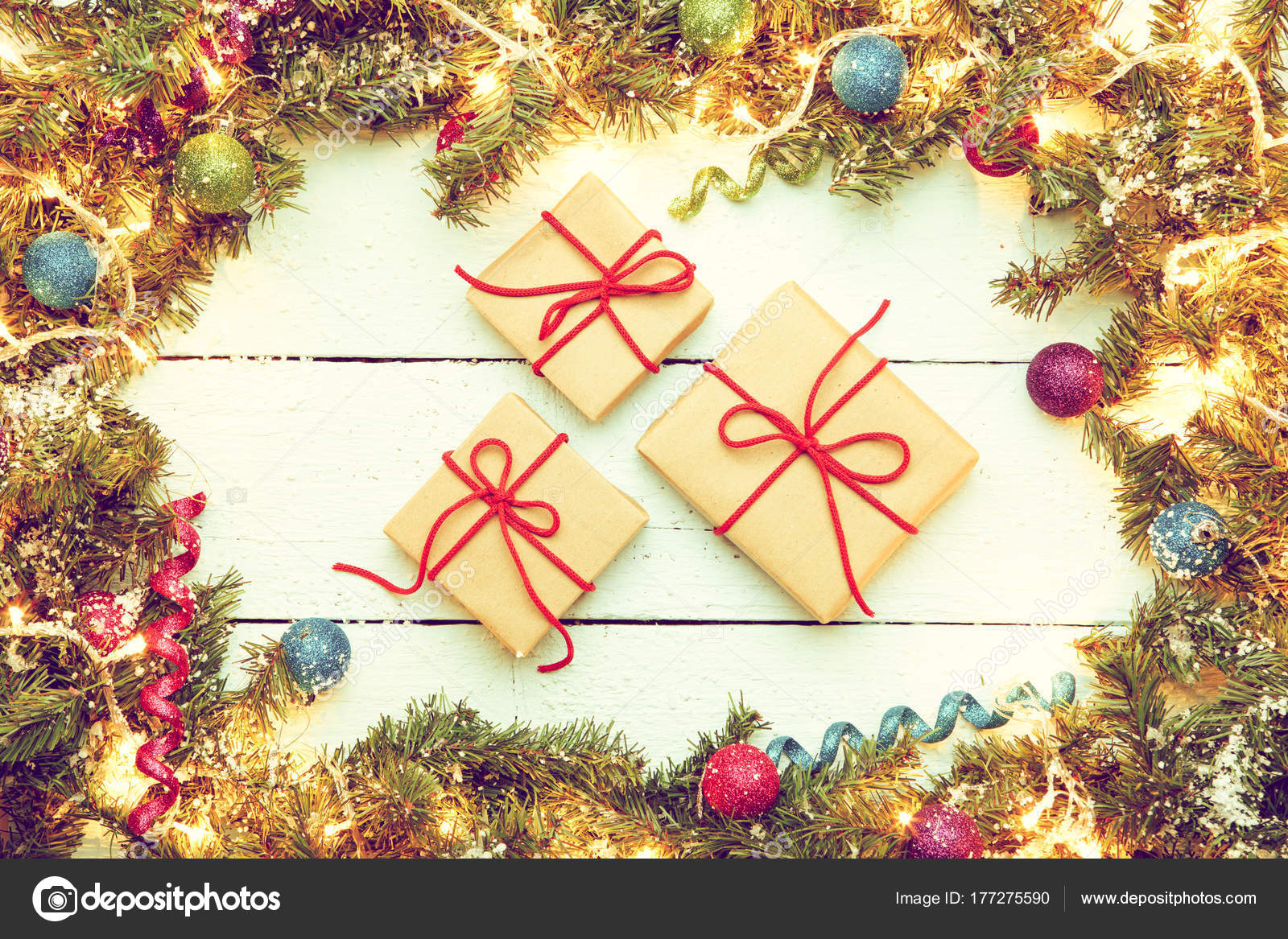 Christmas wooden background with decor frame and three gift boxe ...