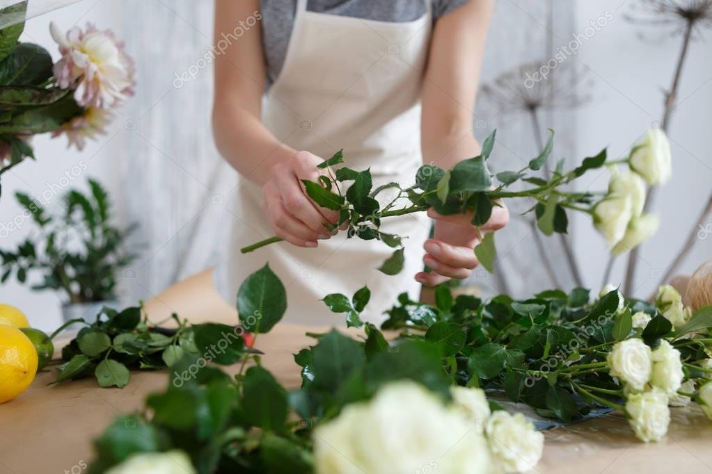 Young florist woman with roses