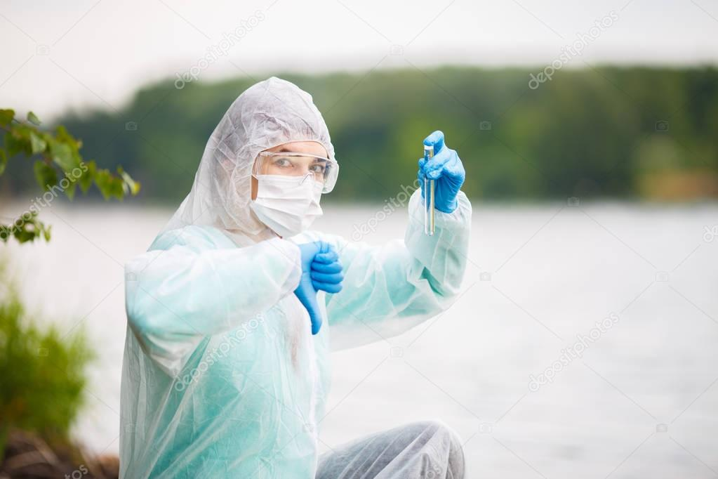 Ecologist with test-tube in mask