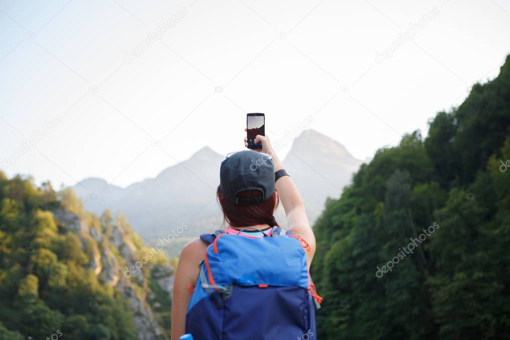 Picture from back of woman hiker with backpack